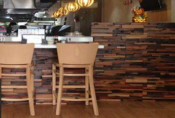 Sushi Station Brisbane featuring the versatility of reclaimed wooden wall cladding by Renaza